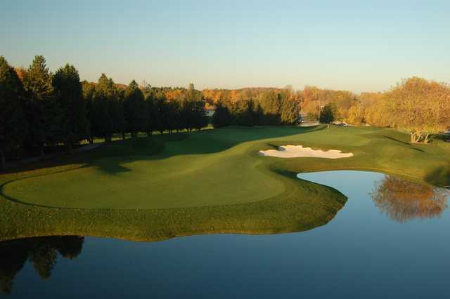 A view over the water of hole #18 at Shawneeki Golf Club