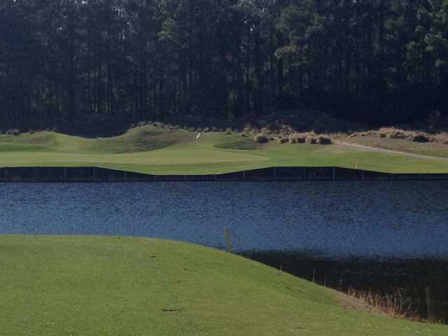 A view over the water of the 13th green at Prestwick Country Club