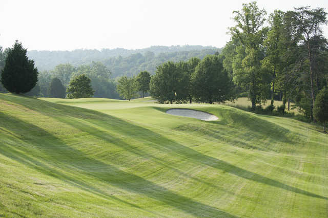 A view of a green protected by a bunker at Oak Ridge Country Club