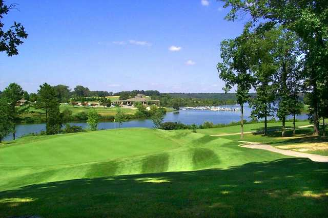 A view of a green with water in background at Tanasi Golf Club.