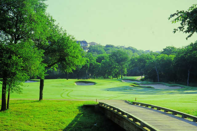 A view over a bridge at Twin Creeks Country Club
