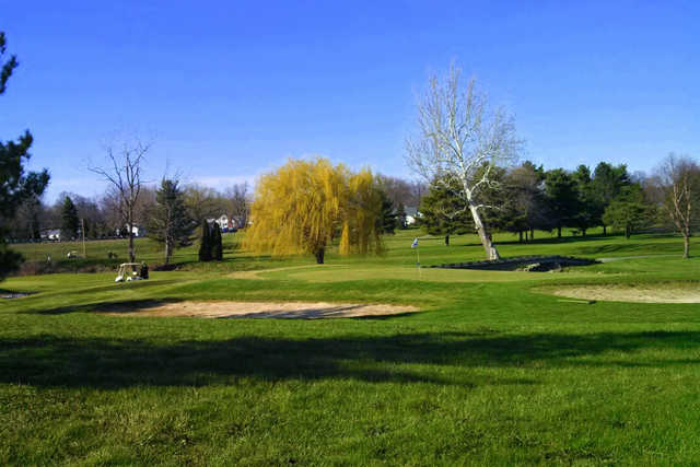 A view of a green protected by bunkers at Springbrook Golf Club