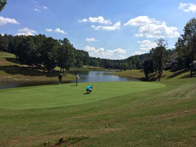 A view of a green with water coming into play at Terri Pines Country Club