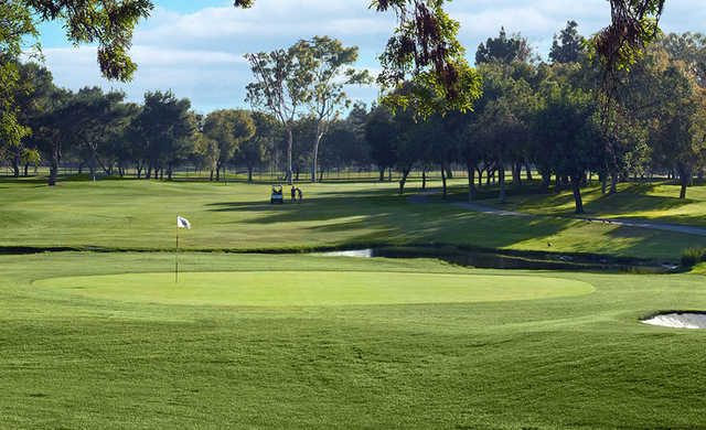A sunny day view of hole #1 at El Dorado Park Golf Club.