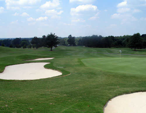 A view of a hole protected by bunkers at Summit Chase Country Club