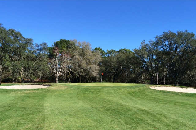 A view of the 1st green flanked by bunkers at Heather Golf & Country Club