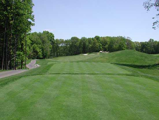 View of the 1st hole of Tashua Glen (Par 4, Dogleg Left) from the back tee.
