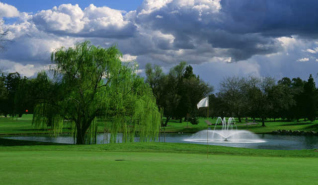 A view of a hole with a water fountain in background at Valley Hi Country Club.