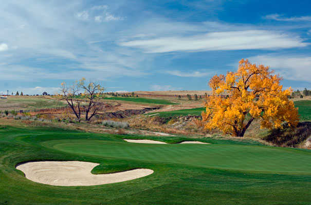 A view of a hole protected by bunkers on both sides of the green at Blackstone Country Club