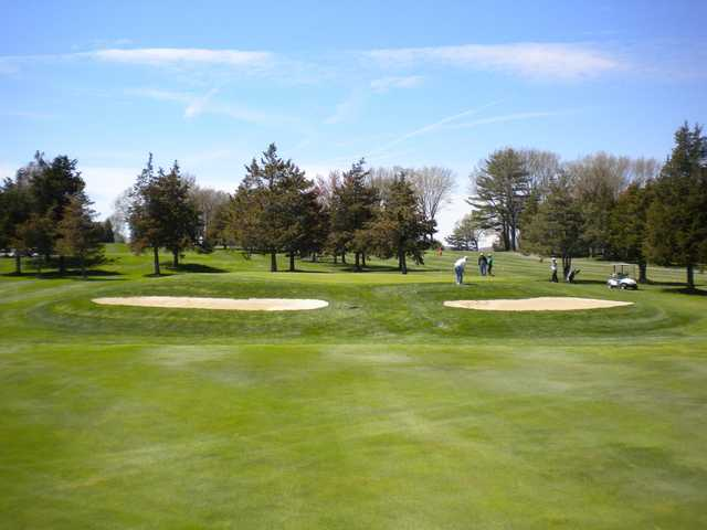 A view of a hole protected by bunkers on both sides at Blackstone Country Club