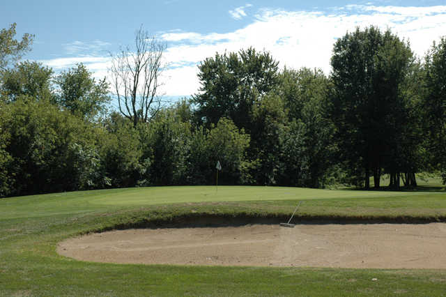 A view of the 3rd green protected by a bunker at Buena Vista Golf Course