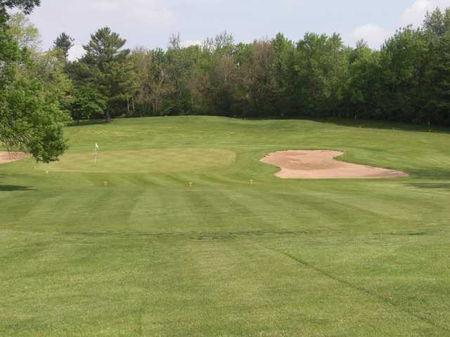 A view of a green flanked by bunkers at Edgebrook Country Club