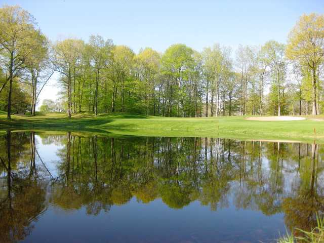 A view over the water of the 8th green at Tallwood Country Club