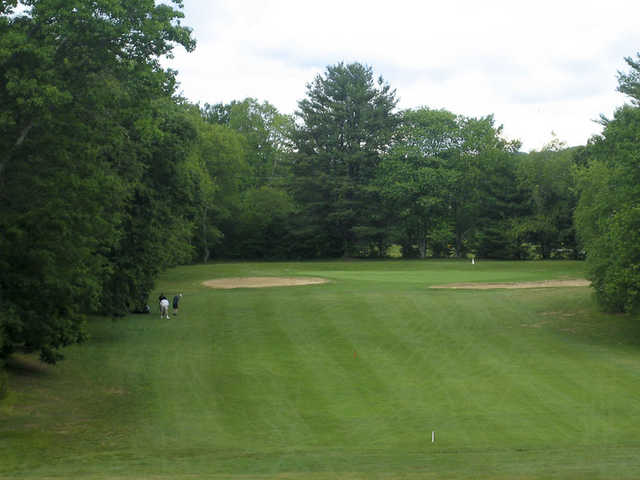 A view of a green guarded by bunkers at Chanticlair Golf Club
