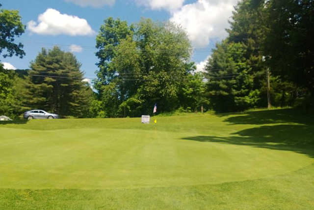 A view of a green at Hop Brook Golf Course
