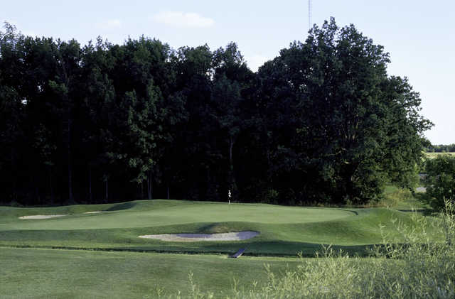 A view of a green surrounded by bunkers at The Meadows.