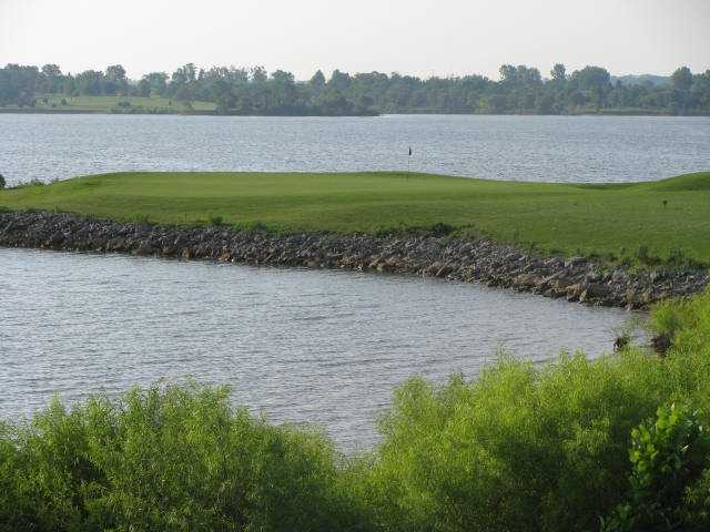 A view of a hole surrounded by water at Posse from Paradise Pointe Golf Complex.