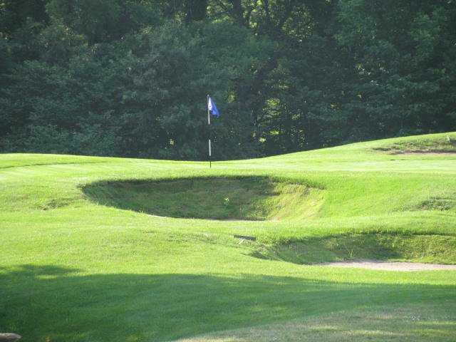 A view of a green protected by bunkers at Paradise Pointe Golf Complex