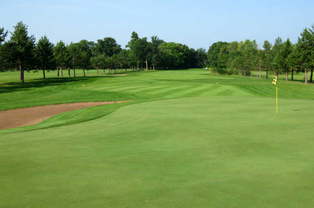 A view of a green protected by bunker at Fiddlestix Golf Course