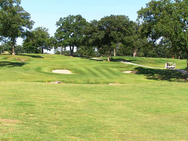A view of a green protected by sand traps at Carthage Golf Course