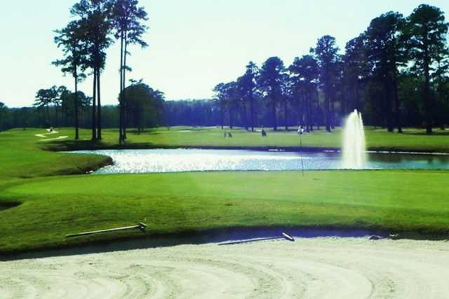 A view of a green with water coming into play from The Pines at Elizabeth City