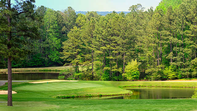 A view of a hole with water and sand traps coming into play at Foxfire Resort & Golf Club