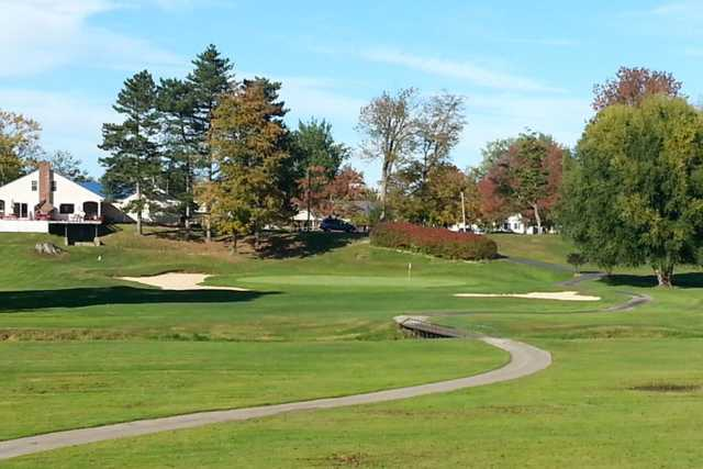 A view of a green flanked by bunkers at Geneva-on-the-Lake Golf Course