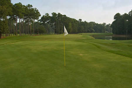 A view of a green at Rolling Acres Golf Course