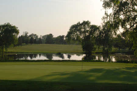 A view of a green with water coming into play at Rolling Acres Golf Course