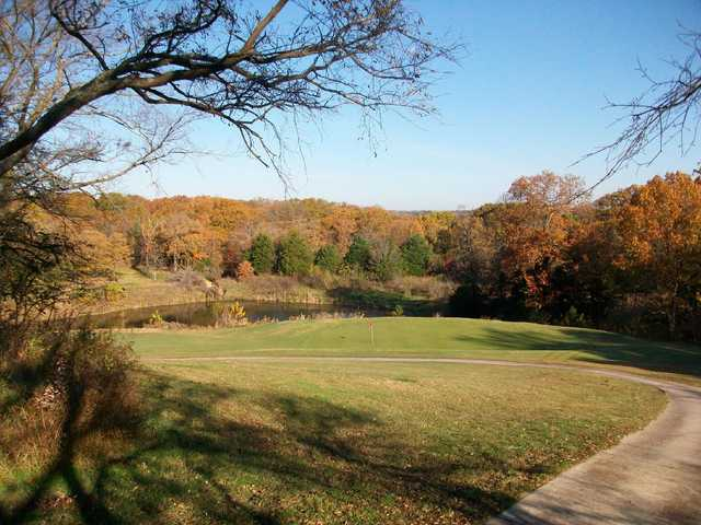 A fall view of a hole with water coming into play at Buncombe Creek Golf Course