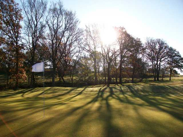 A sunny day view of a hole at Buncombe Creek Golf Course