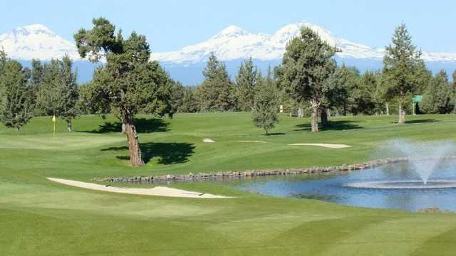 A view of a green with snowy mountains in background from Greens at Redmond