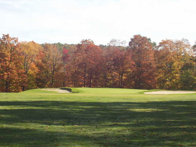 A view of a green flanked by bunkers at Champion Lakes Golf Course