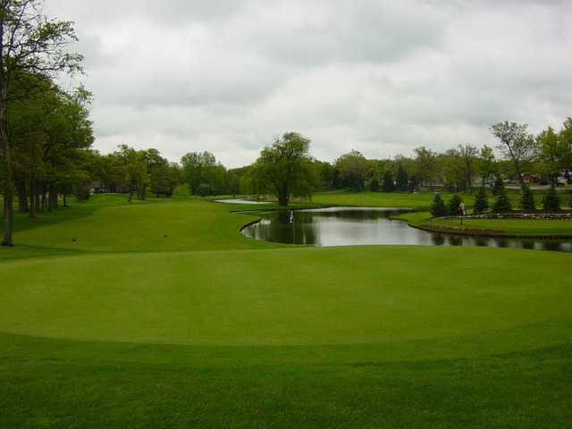 A view of a green with water coming into play at Bay Pointe Golf Club