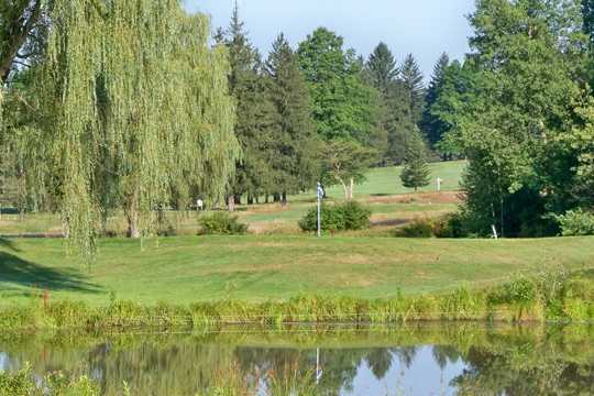 A view over the water of a green at DuBois Country Club