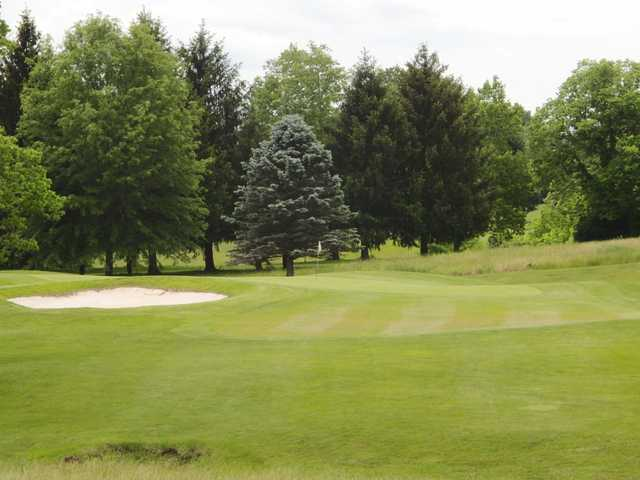 A view of a hole protected by  a bunker at Lewistown Country Club
