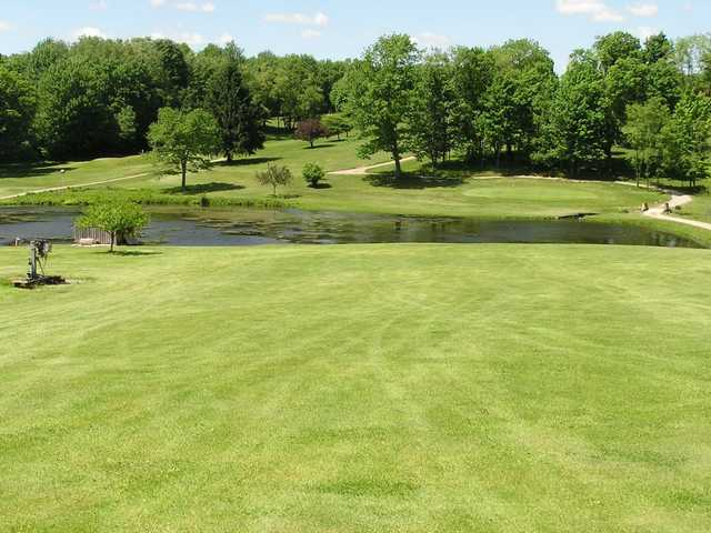 A view over the pond of the 4th green at Whispering Pines Golf Course