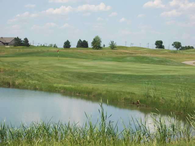 A view over the water of a green from Prairie Bluff Golf Club