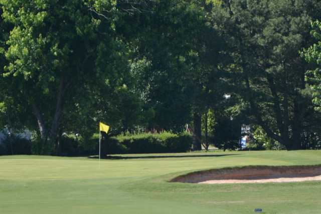 A view of a hole protected by bunkers at Country Club of Newberry