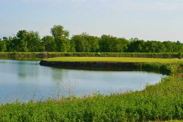 A view of a green surrounded by water at Hoot's Hollow at Country Creek Golf Club