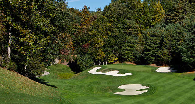 A view of a green protected by bunkers at Champion Hills Golf Club