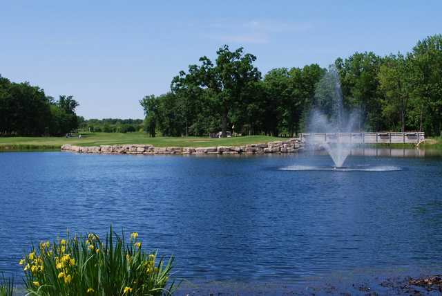 A view of a hole with a water fountain in foreground at Cantigny Golf