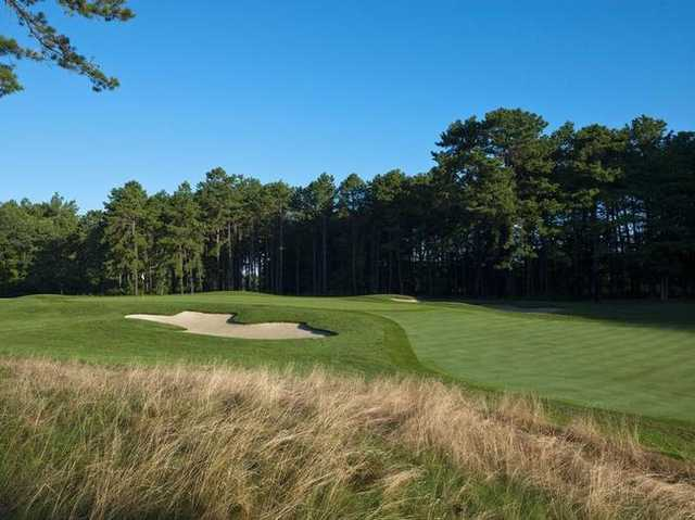 A view of a green protected by tricky bunkers at Metedeconk National Golf Club