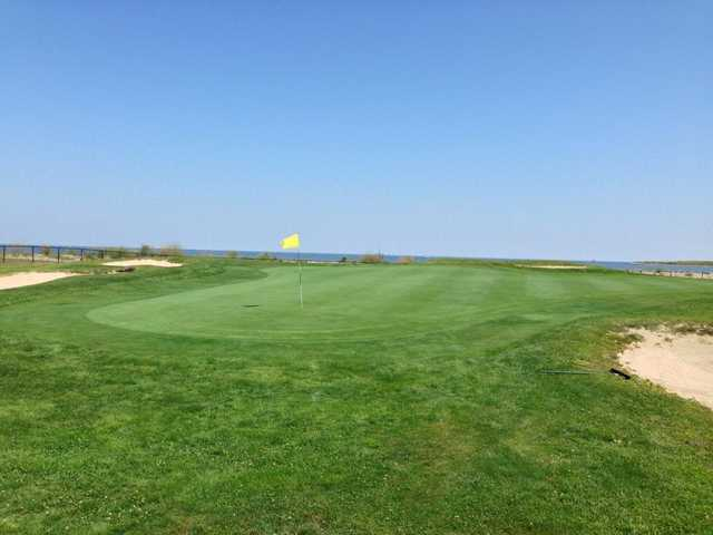 A view of a green protected by bunkers at Short Beach Golf Course