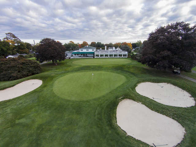 A view of a green surrounded by bunkers at Mill River Country Club