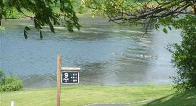 A view of the 9th tee sign at Rolling Green Golf Course