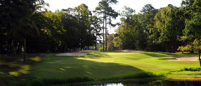 A view of a green surrounded by bunkers at Snee Farm Country Club