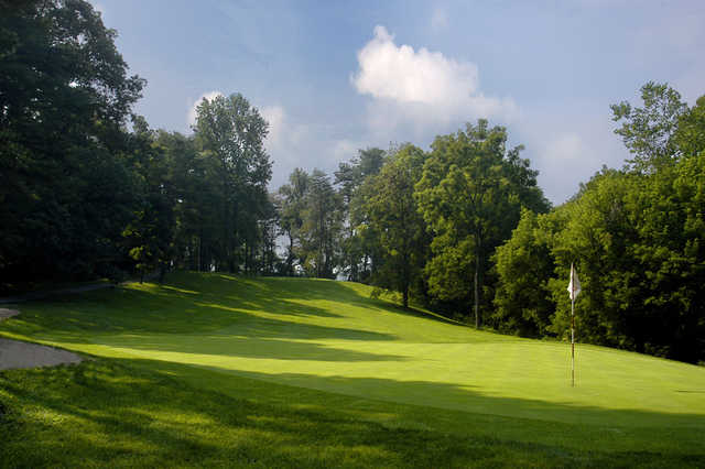 A sunny day view of a hole at Oxbow Golf & Country Club