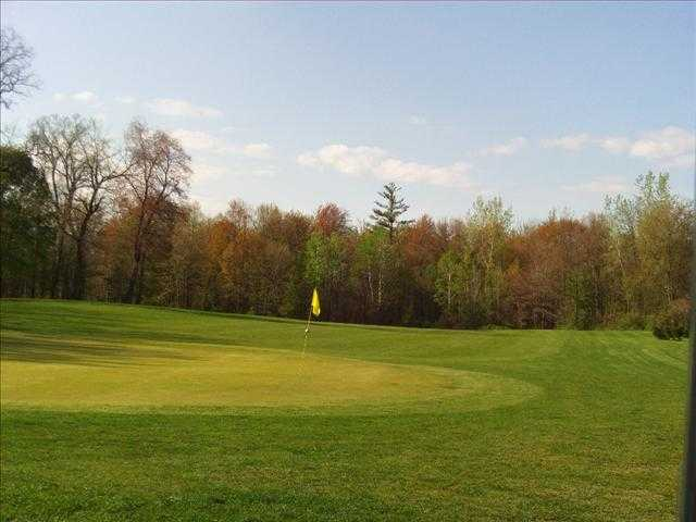 A fall view of a green at Big Oak Golf Course