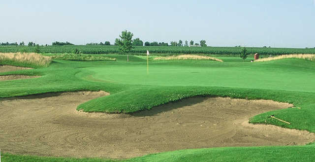 A view of a hole protected by bunkers at Prairie Green Golf Course.